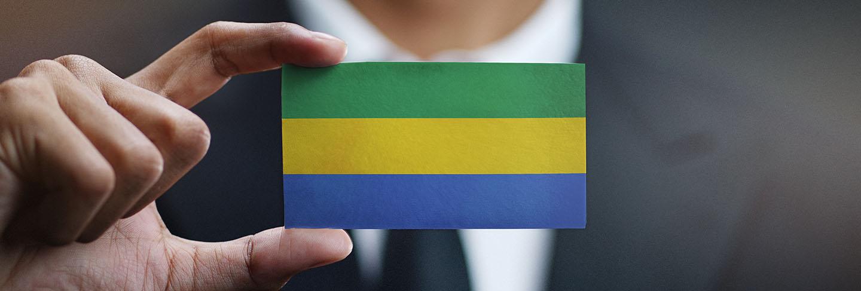 Businessman holding card of gabon flag