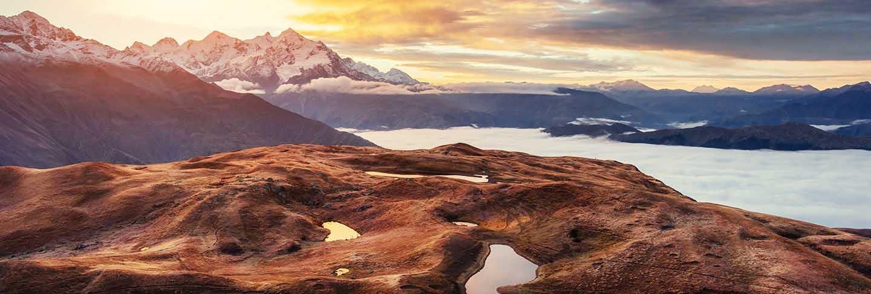 Sunset on mountain lake koruldi. upper svaneti, georgia, europe