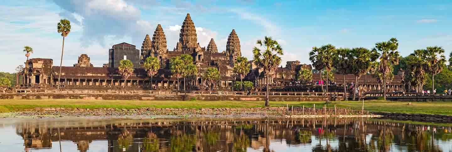 Angkor wat sunny day blue sky main facade reflection on water pond sunset light