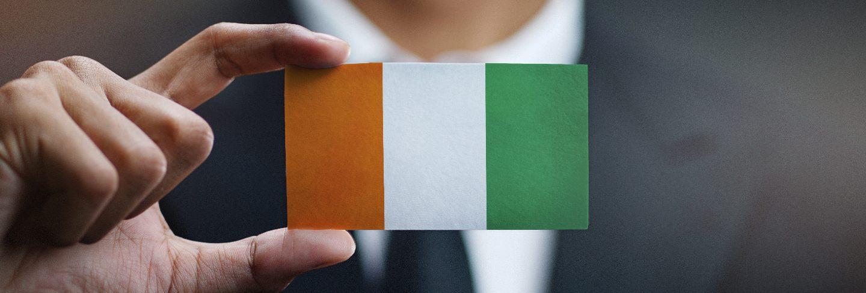 Businessman holding card of ivory coast flag