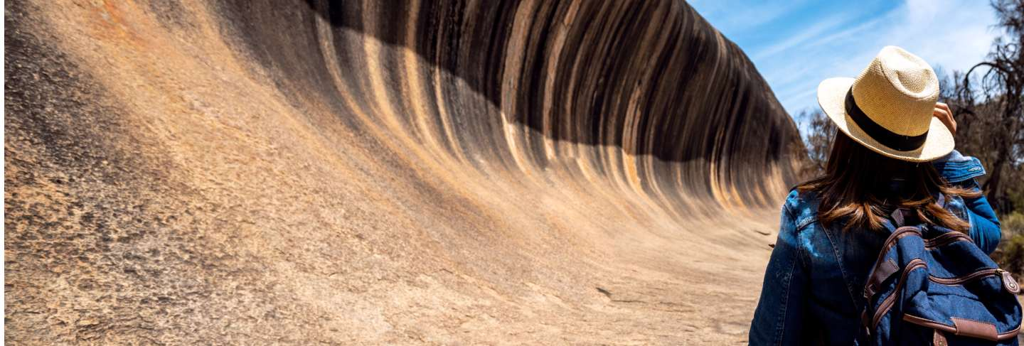 Lady backpack travel in wave rock