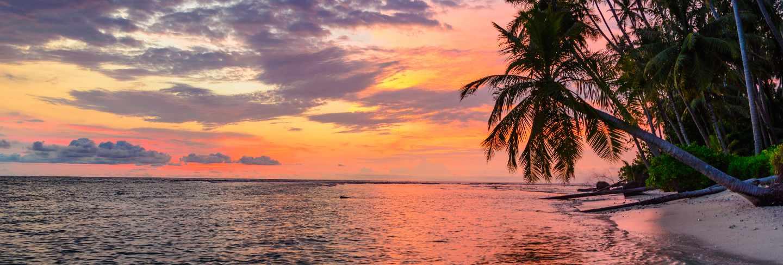 Sunset dramatic sky on sea, tropical desert beach