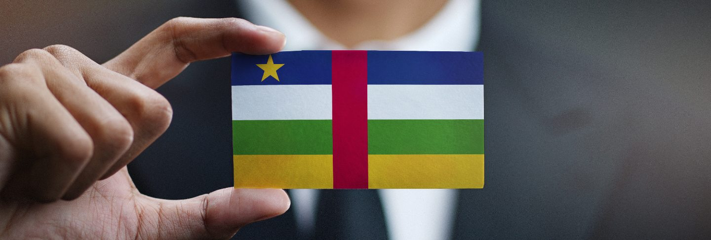Businessman holding card of central african republic flag