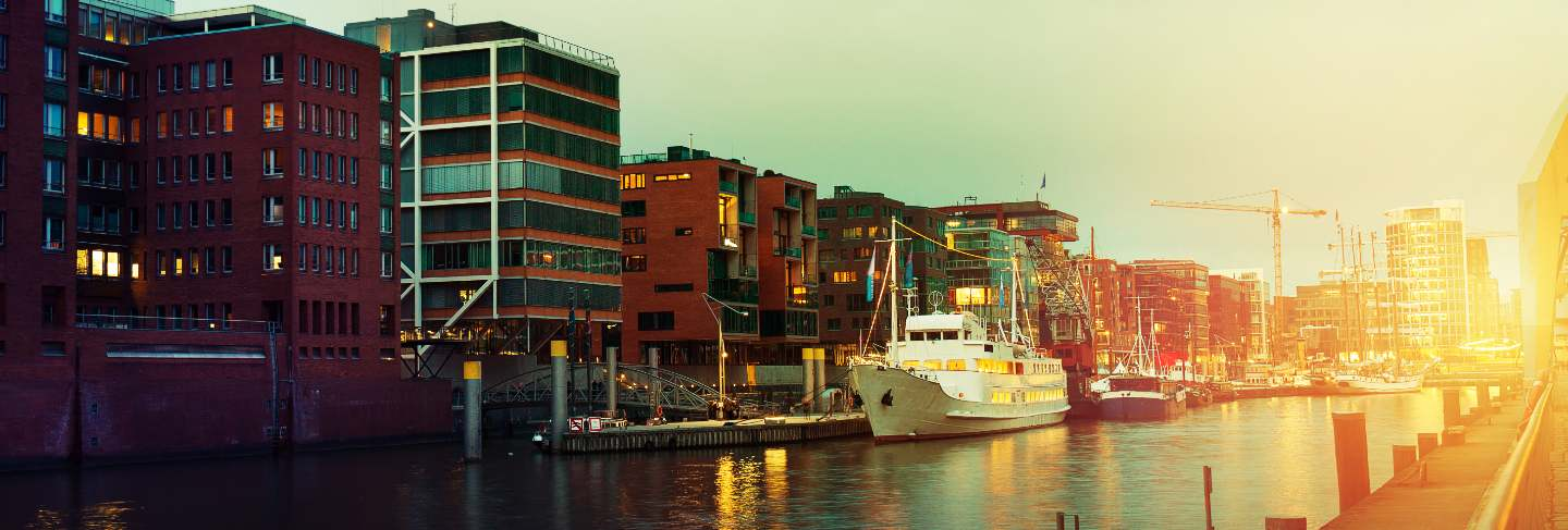 Beautiful picture of sunset in port city with water, ships and bridge. toning. hamburg, germany.