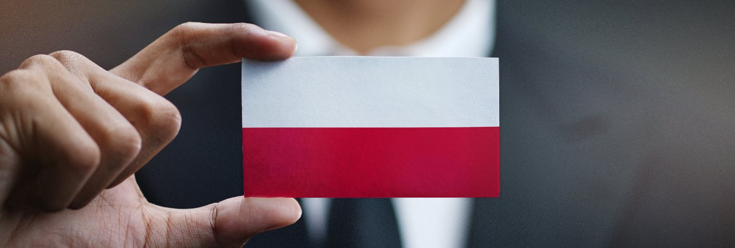 Businessman holding card poland flag