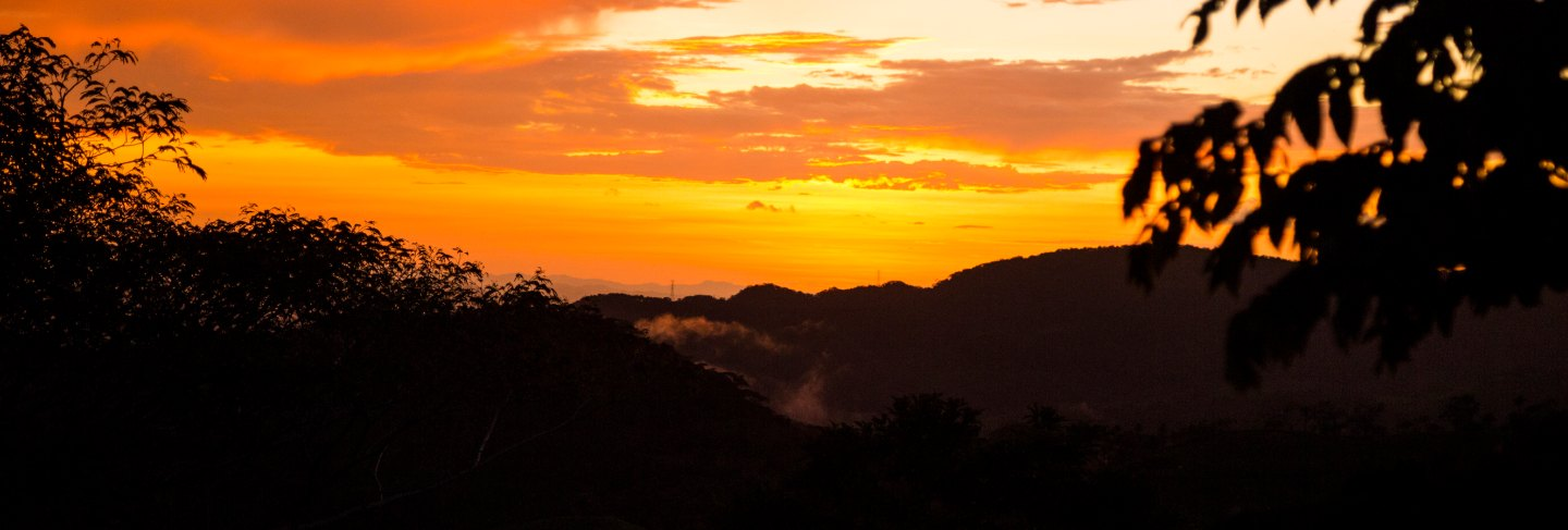 Colorful sunset over the mountain hills