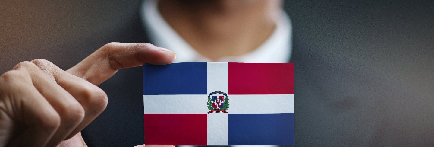 Businessman holding card of dominican republic flag