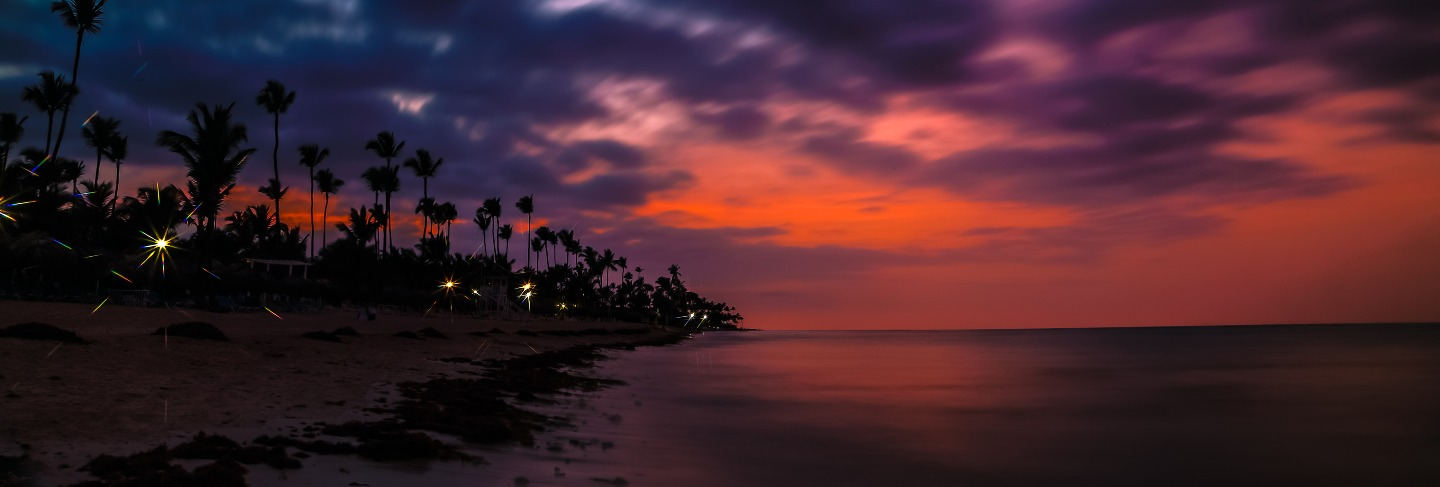 Dramatic sunset over the exotic beach, with palms