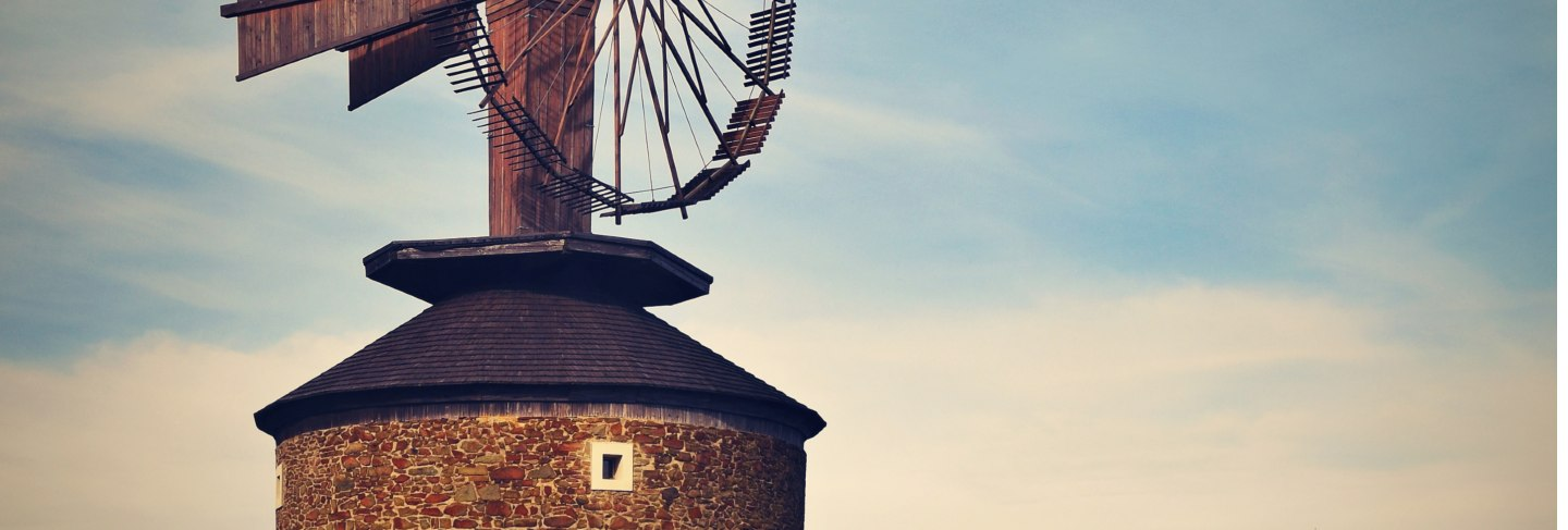 Beautiful old windmill at sunset with sky and clouds. ruprechtov - czech republic - europe.