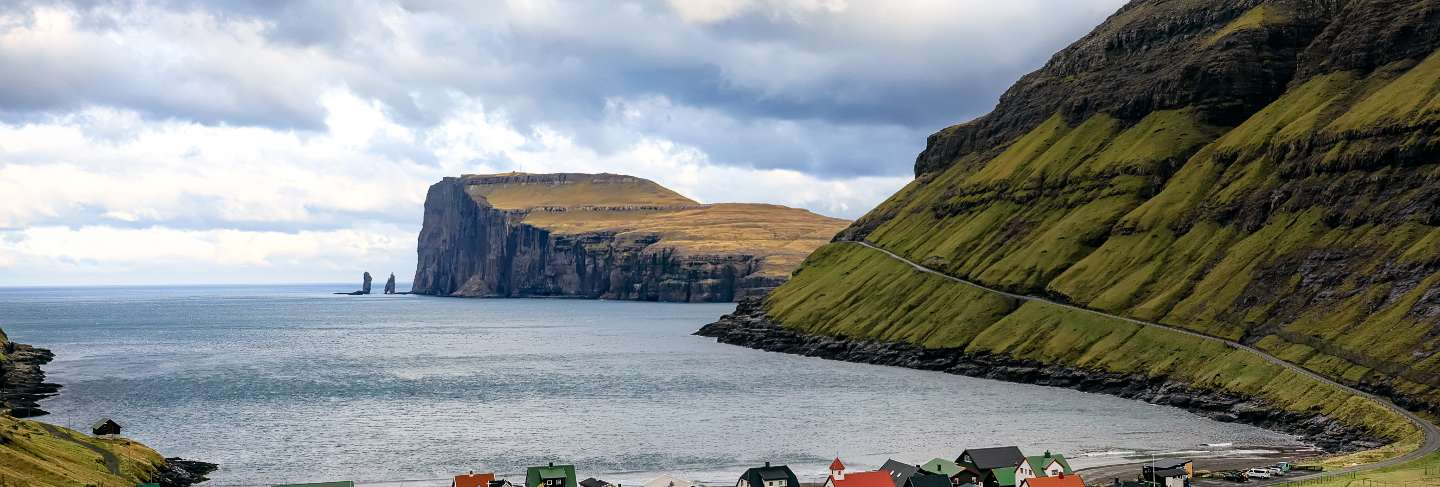 Tjornuvik village and two sea stacks on faroe islands