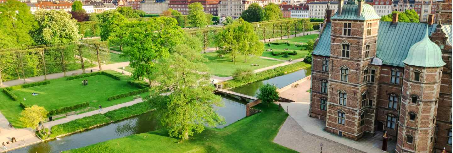 Aerial view of rosenborg slot castle and beautiful garden from above, kongens have park in copenhagen, denmark