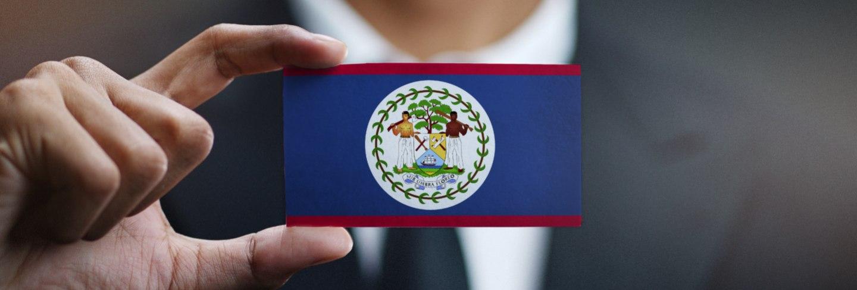 Businessman holding card of Belize flag