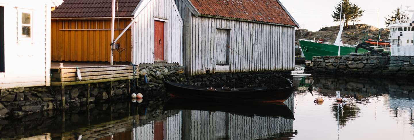 Wood houses reflected in the water
