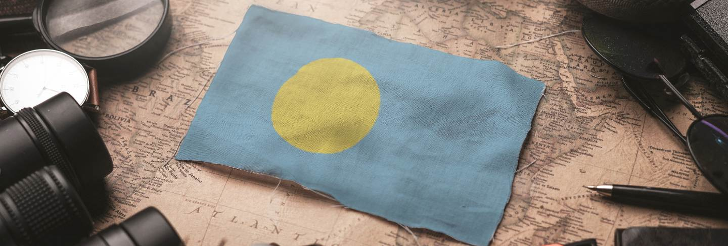 Palau flag between traveler's accessories on old vintage map. tourist destination concept