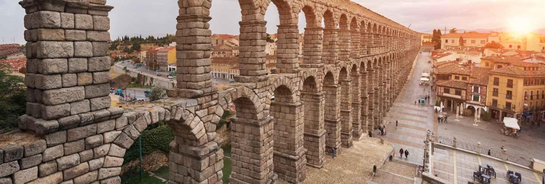 Dramatic sunset in famous segovia aqueduct, castilla y leon, spain