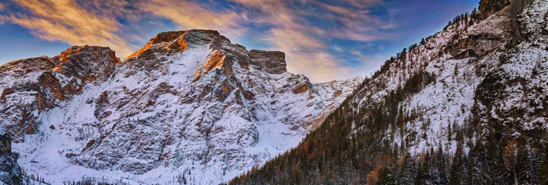Winter sunrise over lago di braies, dolomites, italy