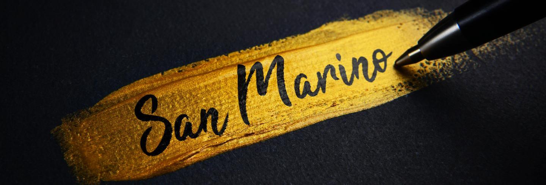 San marino handwriting text on golden paint brush stroke