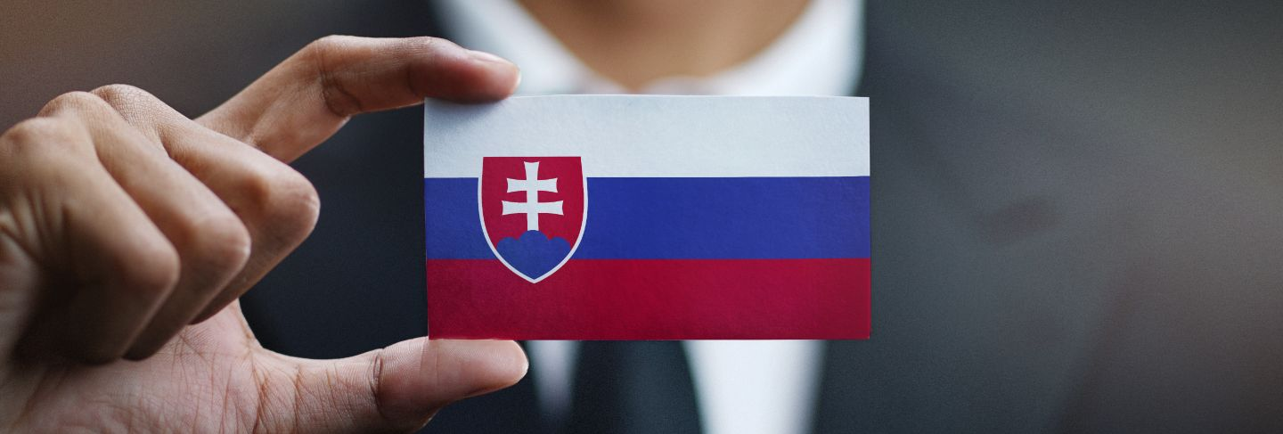 Businessman holding card of slovakia flag