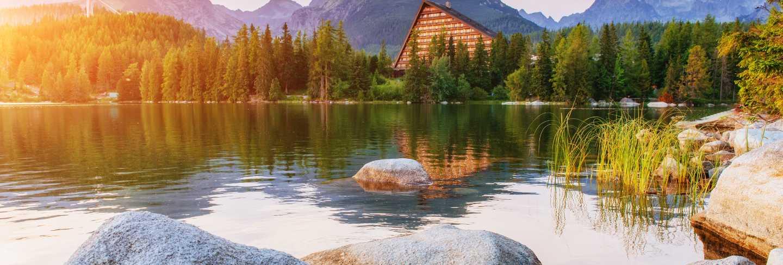 The sunrise over a lake in the park high tatras. strbske pleso,
