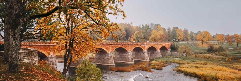 Autumn landscape. the old brick bridge across the venta river in kuldiga, latvia