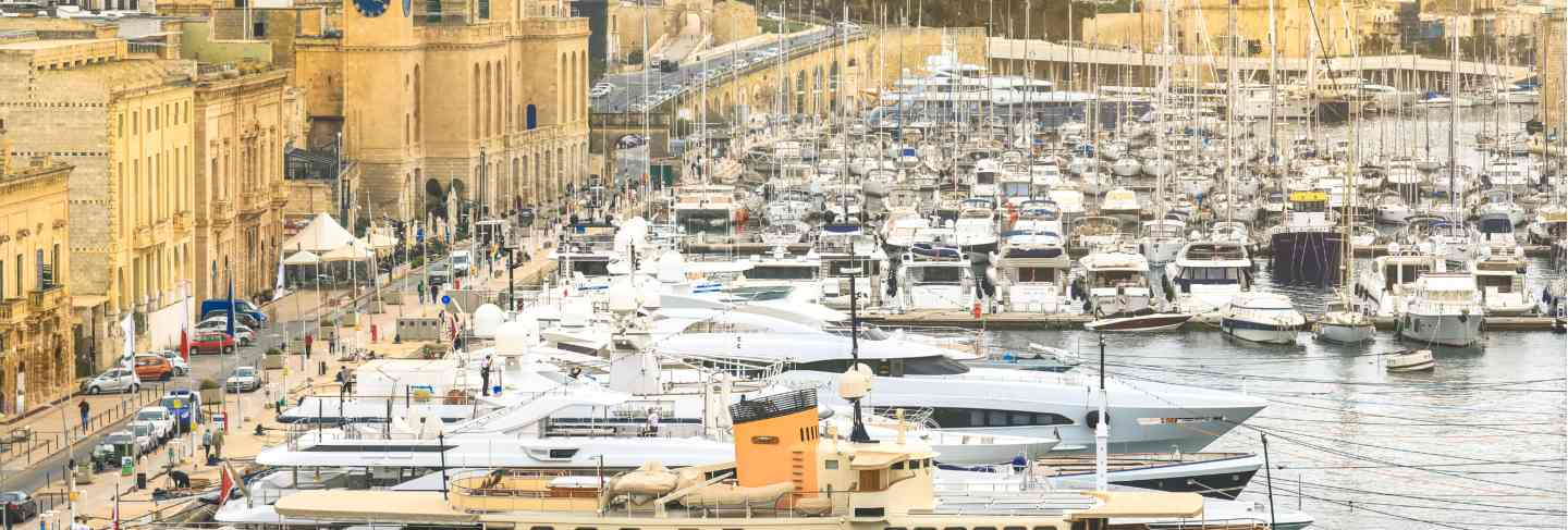 The valletta port is a popular tourist attraction full of cafes and restaurants. Premium Photo