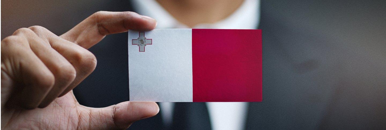 Businessman holding card of malta flag Premium Photo