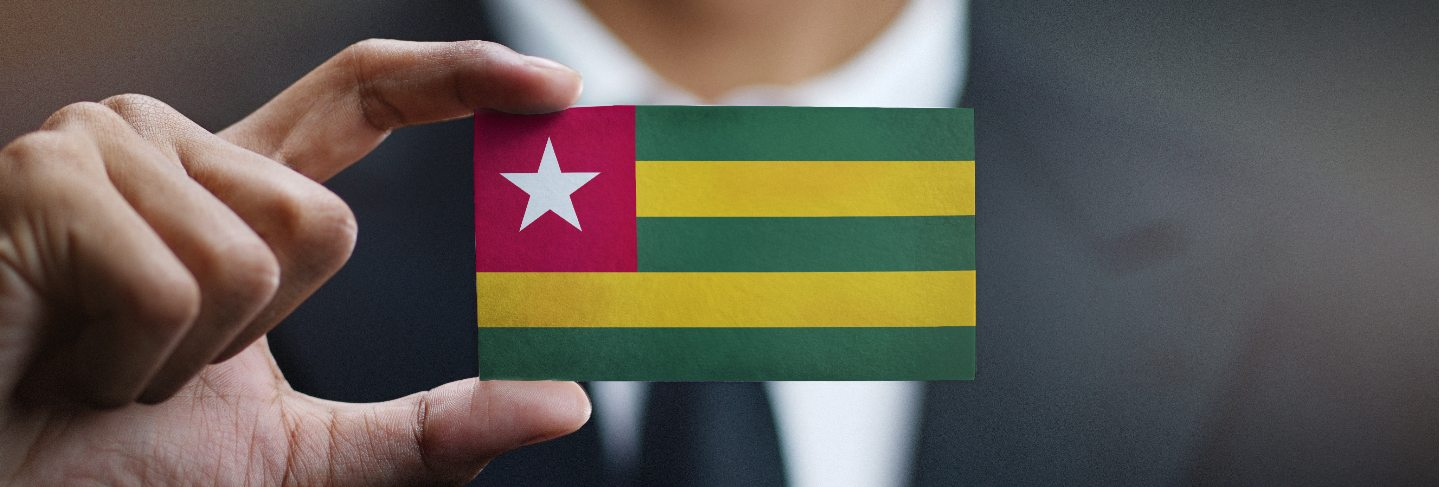 Businessman holding card of togo flag