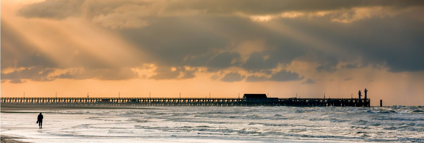 Walk on the beach to the palace pier at blankberg (belgium) on the fascinating north sea