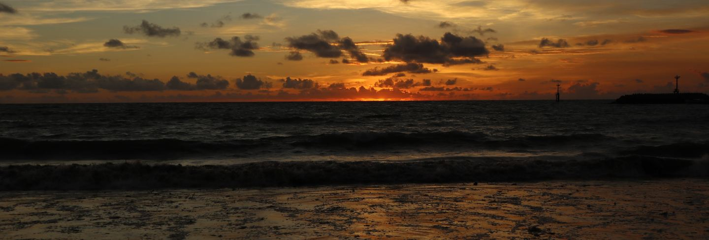 Beautiful scenery at the beach with sunset and clouds in bali, indonesia