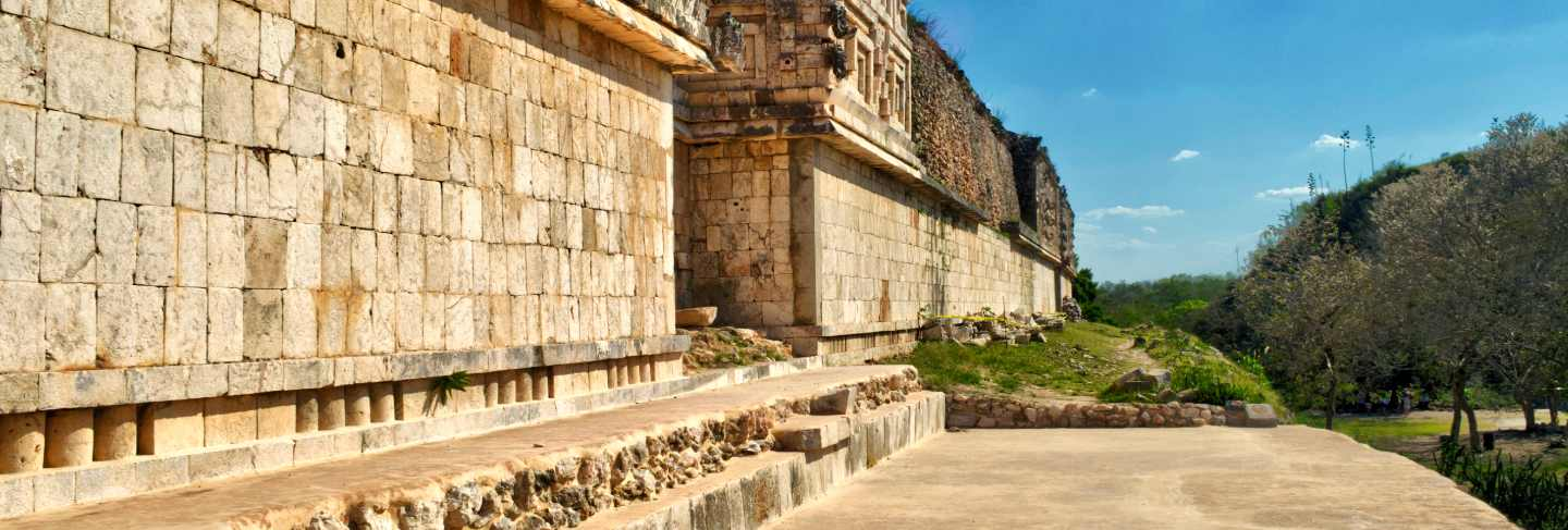 Stones carved in buildings surrounding the courtyard of uxmal. uxmal archaeological site, located in yucatan. beautiful tourist area.