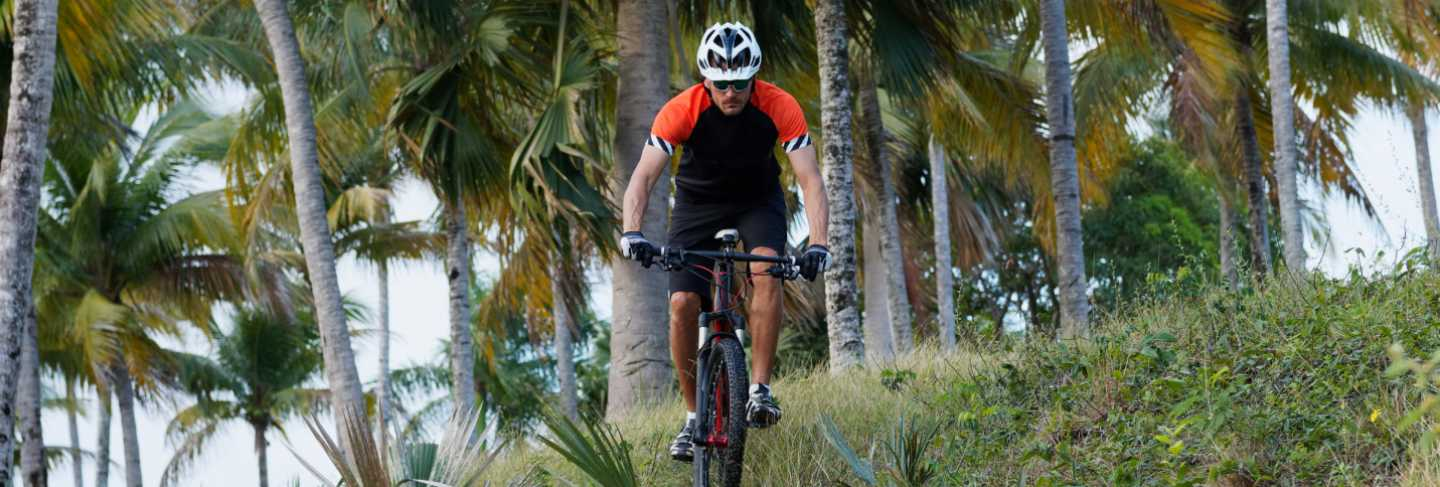 A cyclist rides a mountain bike in the dominican republic