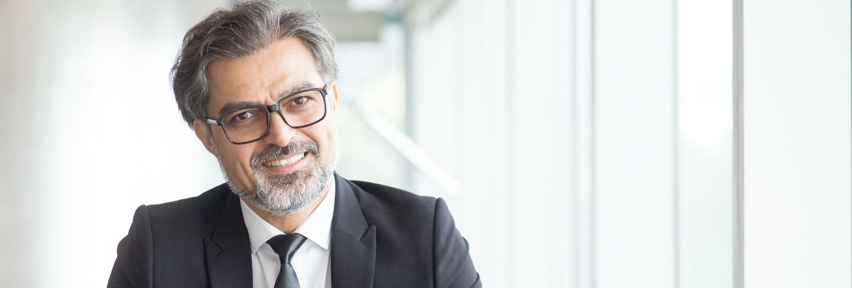 Cheerful businessman in eyeglasses in office
