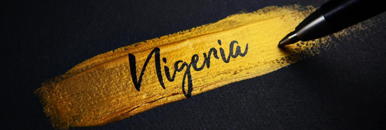 Nigeria handwriting text on golden paint brush stroke