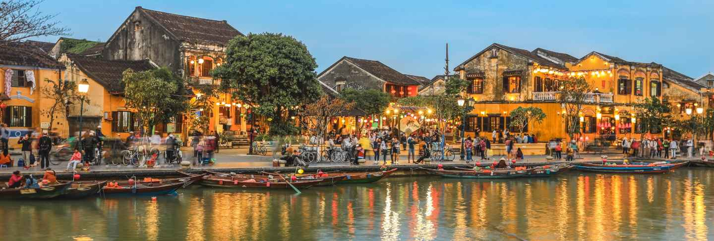 Full of tourists walking on street in hoi an ancient town at dusk