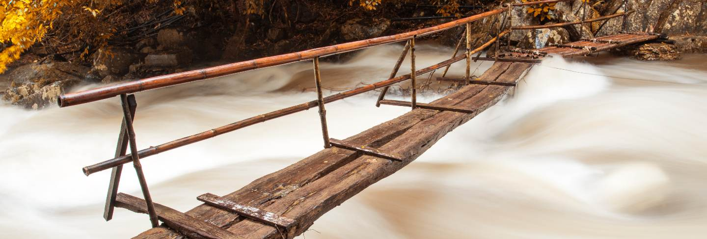 Wooden bridge over the waterfall
