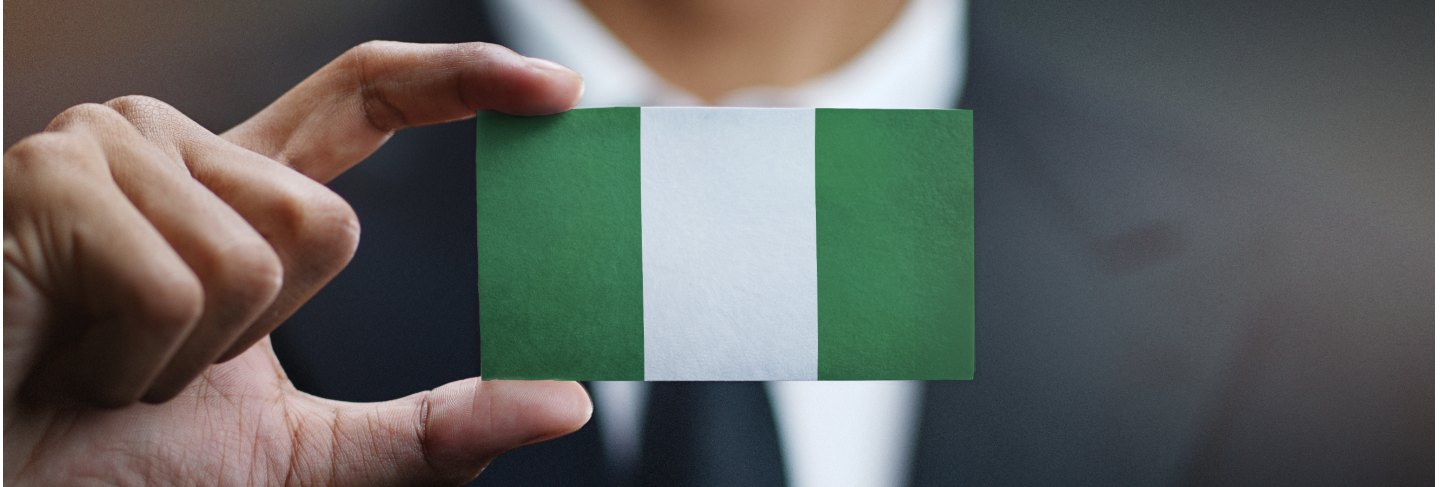Businessman holding card nigeria flag