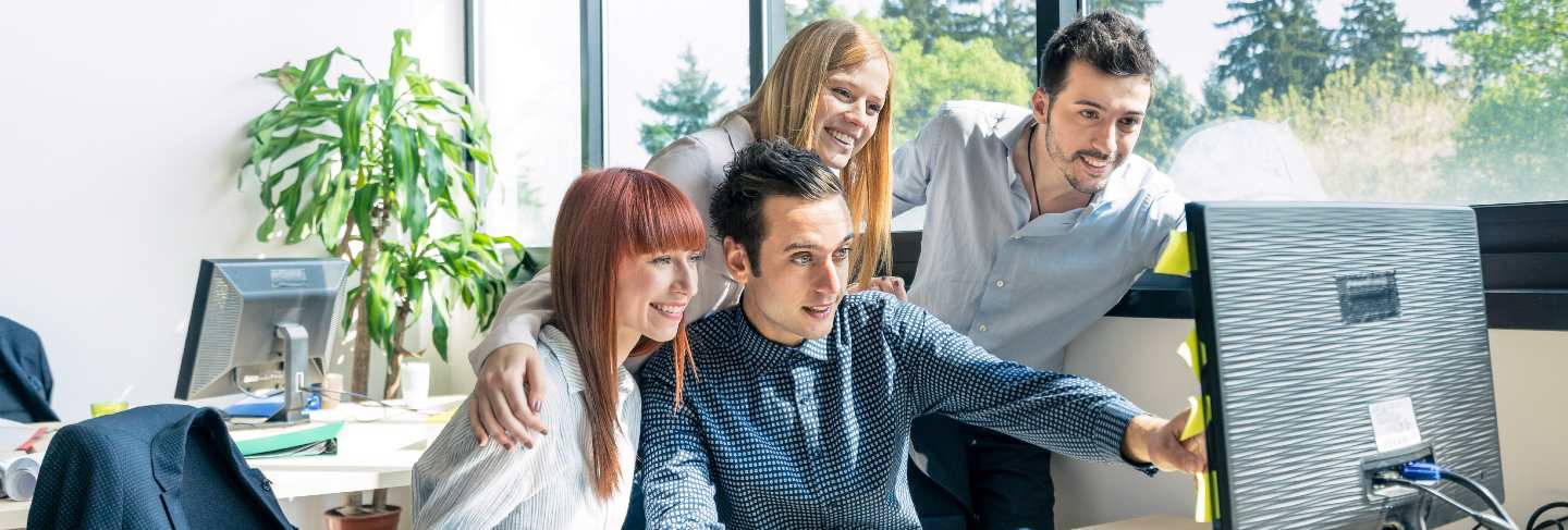 Group of young people employee workers with computer in urban alternative office