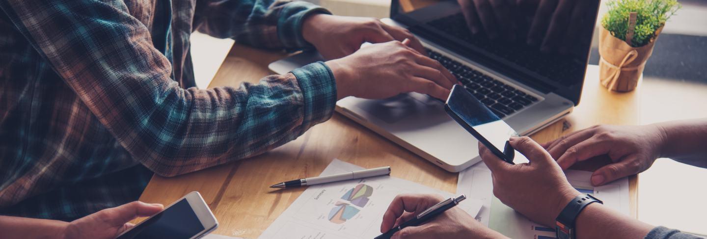 Team business job . working with laptop in open office. meeting report in progress