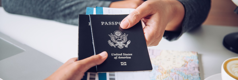 Hand for tourist holding passport to authorities