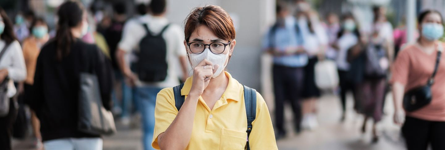 Young asian woman wearing protection mask against novel coronavirus (2019-ncov) or wuhan coronavirus at public train station,is a contagious virus that causes respiratory infection.