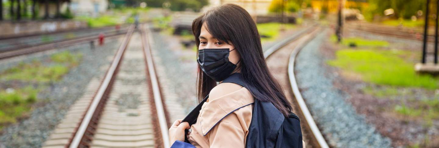 Asian female tourists wearing masks prevent covid-19